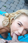 Golden-haired spinner Alina West giving blowjob outdoors on her knees