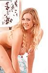 Lustful blondie Sapphire enjoys posing in her white shirt