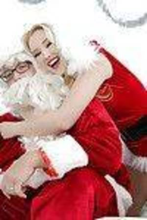 Carnal golden-haired Harley Q is screwing with some Christmas toys!