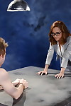 Little nerdy redhead in glasses Roxanne Rae stretches legs for cum-hole eating