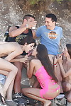 Sexually intrigued coeds with untamed bodies have some groupsex joy with hung lads outdoor