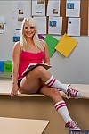Golden-haired coed babe Kimmy Olsen shows her hairless love-cage leaving socks on