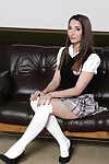 Elegant schoolgirl Jimena Logo posing extremely clothed in school
