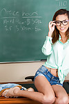 Hawt schoolgirl Alina Li is posing in her glasses on a table