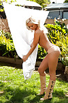 Seductive blonde coed Brandi Lynn posing exclusively covered outdoor
