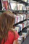 Biggest gazoo brown hair model Emma getting without clothes and flashing in a library