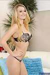 Full-bosomed model Natalia Star slipping off her costume and underwear