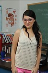 Sexually aroused coed in glasses Scarlet Banks striptease in the classroom