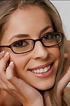 Coed girl in glasses Presley Hart enjoys smokin\' pussy with fingers