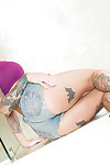 Inked solo example Kleio Valentien pulling her strings down to masturbate