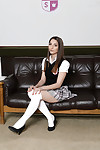 Pretty coed Jimena Lago posing solo in knee high white socks