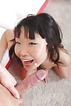 Oriental schoolgirl Candy Vivian gives a oral play and licks the nut sac
