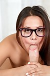 Nasty lalin girl brunette in glasses swallowing a enormous rod and eating