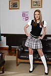 European schoolgirl Dominica Fox modelling perfectly dressed on leather sofa