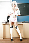 Busty blond solo gal Kenzie Taylor takes her clothes off off schoolgirl outfit and petticoat