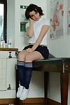 Short haired dear Victoria Porter modeling in petticoat and knee socks