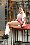 Teen Eastern pornstar Alina Li posing seductively in schoolgirl uniform