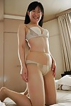 Asian doll Ayane Ikeuchi posing in petticoat and hose bares small love bubbles