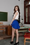 European schoolgirl Megan Maze shows off while undressing her skirt