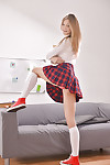 Infant gal Merry Pie removes clothes her schoolgirl uniform and socks