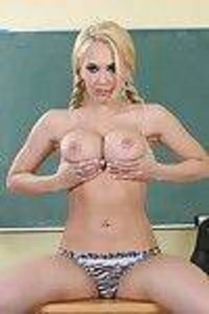 School girl with pigtails Kagney Linn Karter takes her clothes off to flavor her pussy
