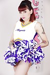 Tattooed schoolgirl cheerleader takes her clothes off for hairless slit spreading