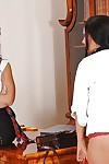 Amateur schoolgirl in knee high socks is put over MILF\'s knee for trouncing