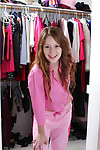 Smiley redhead young Alice Rae undressing and exposing her hairless cooter