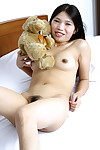 Wavy Chinese teen Diep posing unclothed on her daybed and stretching her legs