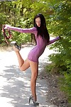 Willowy brunette hair young undressing and posing as was born outdoor