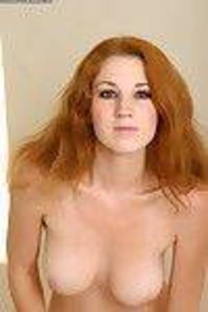 Ample-breasted redhead juvenile undressing and exposing her skinhead wet crack