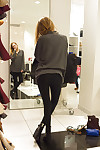 Wiry vivacious fairy-haired youthful Reese Berkman bending over in a store