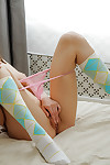 Bosomy young in knee socks entrancing off her undies and playing with she\'s
