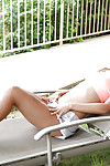 Latina amateur Lindsey Woods is lying on the deck chair and undressing