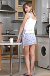 Lean young teen Olga complied to rub her  pussy at the kitchen