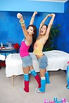 Petite young girls in knee socks erotic dancing and exposing their moist fannies