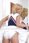 Liberated cheerleader with round boobies getting rid of her uniform