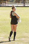 Beefy juvenile coed Deidre Collins posing in spandex shorts and knee highs