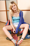 Glamorous young with blond hair Dacha posing and playing with her gentile