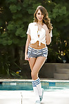 Sweetly pretty pretty with hirsute cooter Riley Reid striptease by the pool