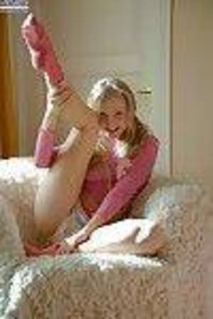 Frisky teenie in pink socks delightful off her shorts and fingering her slit