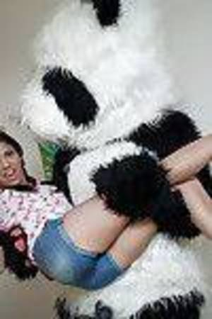 Small youthful dark hair with pigtails erotic dancing and having pleasure with her implement
