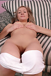 Lusty youthful in white socks and undies undressing and fingering her gash