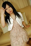 Shy oriental teen getting nude and showing off her hairy gash in close up