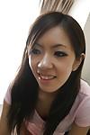 Oriental amateur Harumi Matsuda undressing and exposing her honey pot
