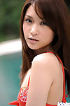 Exquisite asian infant with natty fanny stripping by the pool