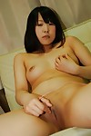 Shy oriental infant Jun Matsuzaki erotic dance down and playing with a vibrator