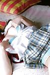 Raunchy Japanese schoolgirl Ayumi Motomura slipping off her uniform