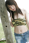 Lusty Chinese teen uncovering her boobs and flashing her bush outdoor