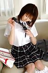 Pretty oriental schoolgirl Akane Sakura erotic dancing off her uniform